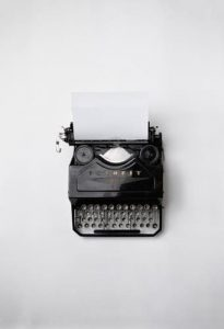 Old-fashioned typewriter against a minimalist setting