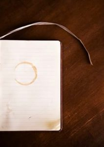 Coffee stain on a blank notebook page