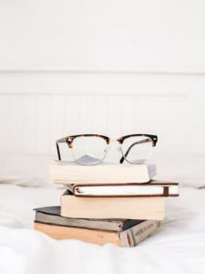 Glasses sitting atop a stack of books