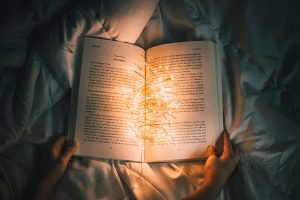 Reading a book under the covers at night